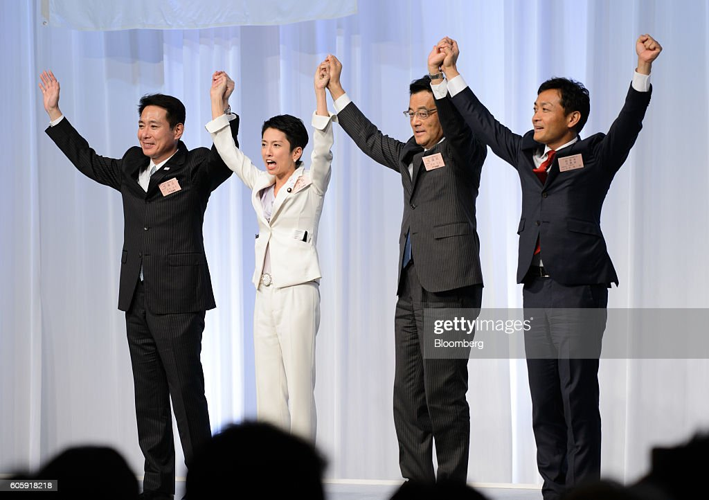 Seiji Maehara, a candidate for president of the Democratic Party of Japan (DPJ) and former foreign minister, from left, Renho Murata, president-elect of the DPJ, Katsuya Okada, outgoing president and founder of the DPJ, and Yuichiro Tamaki, a candidate for president of the DPJ, hold hands following the party's leadership election in Tokyo, Japan, on Thursday, Sept. 15, 2016. Renho, a half-Taiwanese former newscaster, was elected as leader of Japan's main opposition Democratic Party, despite criticism over a last-minute revelation that she had dual nationality. Photographer: Akio Kon/Bloomberg via Getty Images