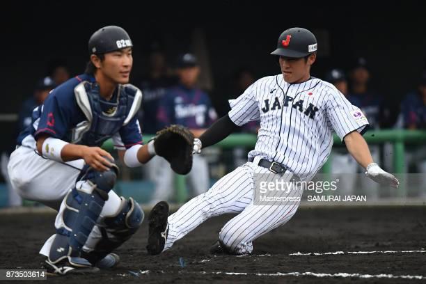 Seiji Uebayashi of Samurai Japan scores a run during a practice game between Japan and Saitama Seibu Lions at Sokken Stadium on November 13 2017 in...