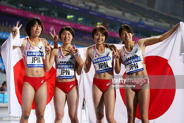 Seika Aoyama Nanako Matsumoto Kana Ichikawa and Asami Chiba of Japan celebrate claiming the Silver medal in the Women's 4x400m Relay Final during day...
