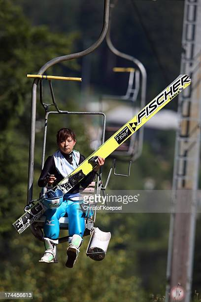 Seiko Koasa of Japan sits on the lift during the women's competition of the FIS Ski Jumping Summer Grand Prix at Rothausschanze on July 26 2013 in...