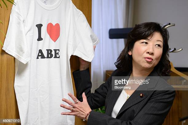 Seiko Noda chairperson for the general council of the Liberal Democratic Party holds a tshirt as she speaks during an interview in Tokyo Japan on...