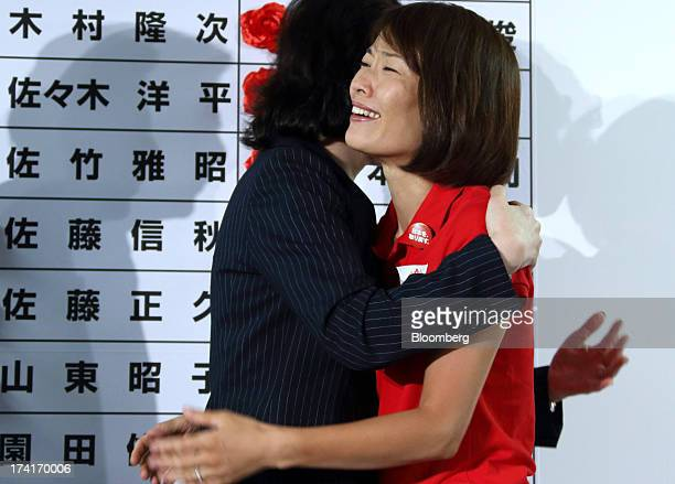 Seiko Noda chairperson of the General Council at the Liberal Democratic Party hugs with Tamayo Marukawa a LDP lawmaker who won an upper house...