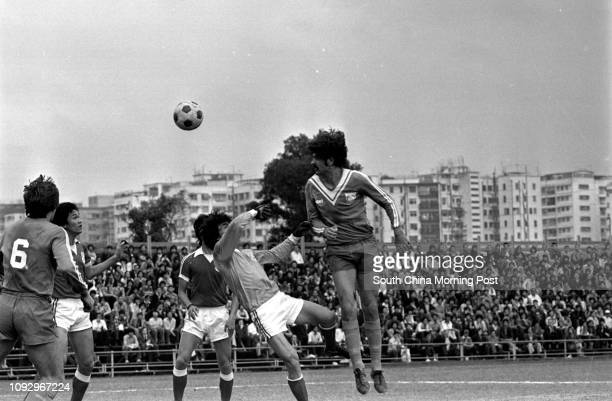 Seiko's Ian McWilliams heads a ball pass Yuen Long goalkeeper Lam Chunshu during their league game at the Police Ground Stadium But the ball just...