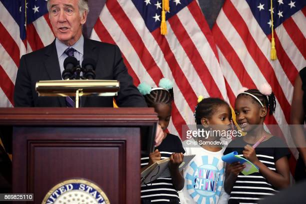 Seilah Tappin and her twin sister Shiloh Tappin and their friend Dani Hebron all 7 years old take notes during a news conference conducted by House...