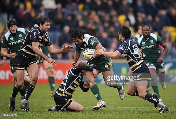 Seilala Mapusua of Irish takes on Matthew Jones, Pat Sanderson and Willie Walker of Worcester during the LV= Cup match between Worcester Warriors and...