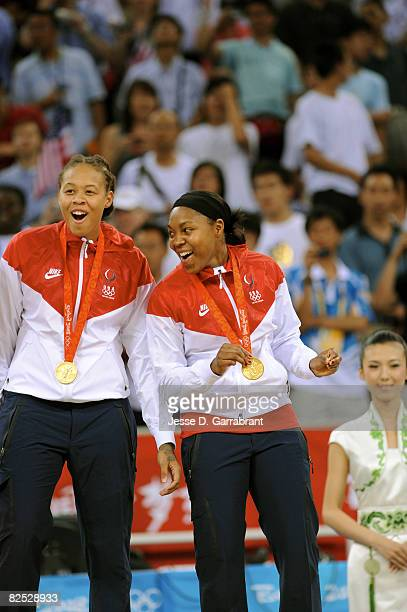 Seimone Augustus and Cappie Pondexter of the U.S. Women's Senior National Team celebrate on the podium after winning the gold medal against Australia...