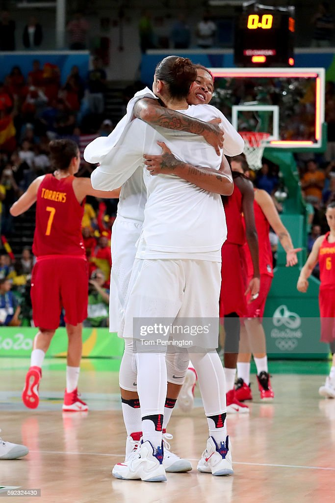 Seimone Augustus #5 and Diana Taurasi #12 of United States celebrate after winning the Women's Gold Medal Game between United States and Spain on Day 15 of the Rio 2016 Olympic Games at Carioca Arena 1 on August 20, 2016 in Rio de Janeiro, Brazil.