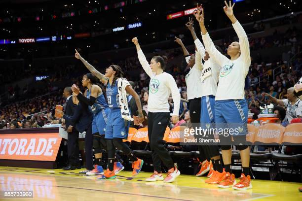 Seimone Augustus and Lindsay Whalen of the Minnesota Lynx with teammates react to a play against the Los Angeles Sparks in Game Three of the 2017...