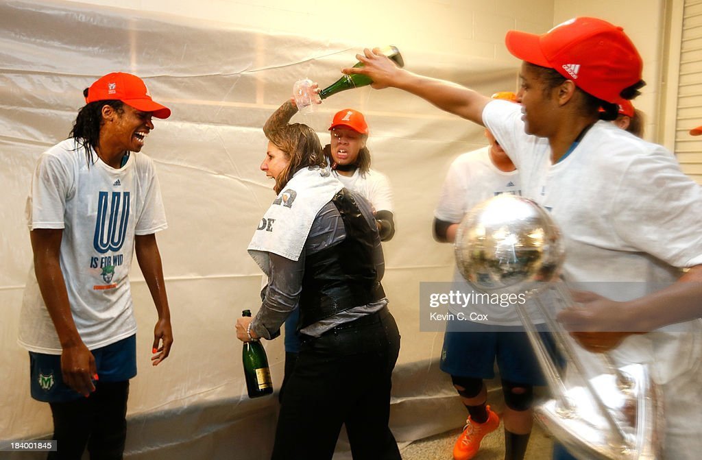 Seimone Augustus #33 and Maya Moore #23 douse champagne on head coach Cheryl Reeve of the Minnesota Lynx as they celebrate their 86-77 win over the Atlanta Dream in Game Three of the 2013 WNBA Finals at Philips Arena on October 10, 2013 in Atlanta, Georgia.