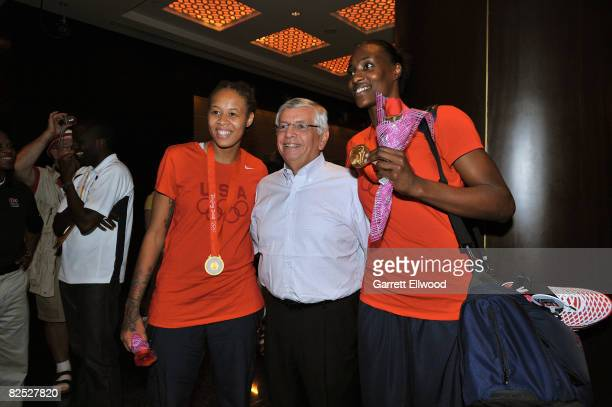 Seimone Augustus and Sylvia Fowles of the U.S. Women's Senior National Team celebrates with NBA Commissioner David Stern after winning the women's...
