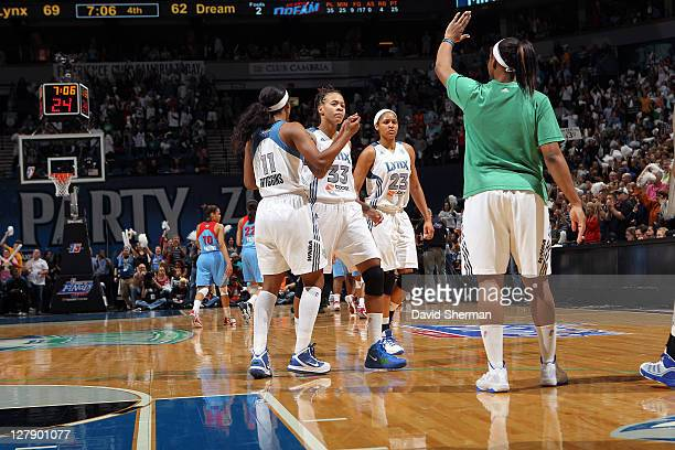 Seimone Augustus celebrates with teammates Candice Wiggins Maya Moore and Monica Wright of the Minnesota Lynx during the game against the Atlanta...