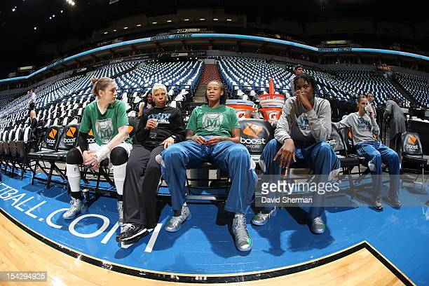 Seimone Augustus Lindsay Whalen Amber Harris Erin Thorn and Assistant Coach Shelley Patterson of the Minnesota Lynx relax prior to the 2012 WNBA...
