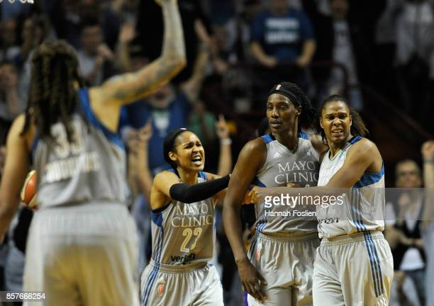 Seimone Augustus Maya Moore Sylvia Fowles and Rebekkah Brunson of the Minnesota Lynx celebrate a foul Fowles by the Los Angeles Sparks during the...