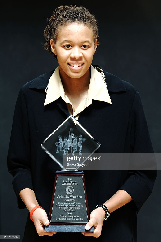 Seimone Augustus, of Louisiana State, poses with her trophy as the winner of the 2005 John R. Wooden award as the nation's best female college basketball player after award ceremonies at the Los Angeles Athletic Club in downtown Los Angeles, Saturday, April 9, 2005.