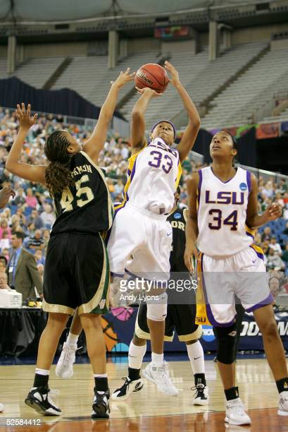 Seimone Augustus of the Louisiana State Lady Tigers puts a shot up over Steffanie Blackmon of the Baylor Lady Bears in the Semifinal game of the...