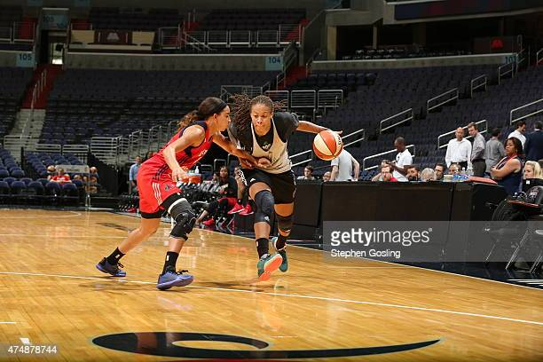 Seimone Augustus of the Minnesota Lynx drives against Bria Hartley of the Washington Mystics during an Analytic Scrimmage at the Verizon Center on...