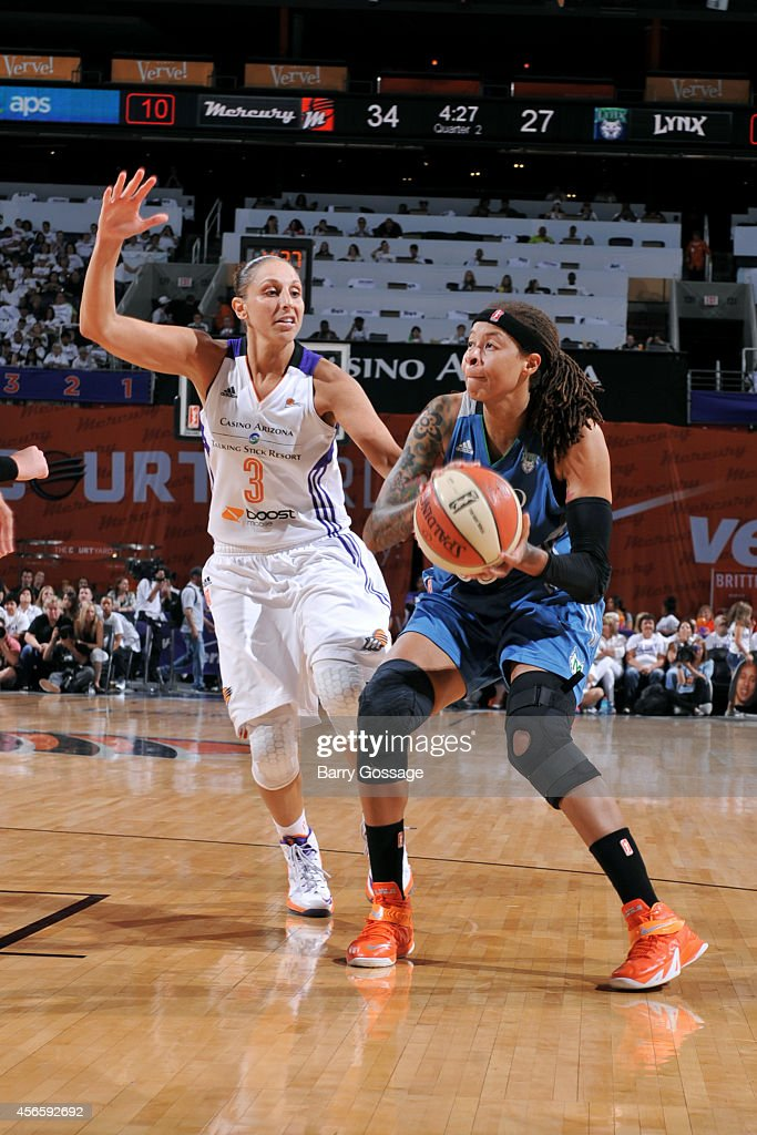 Seimone Augustus #33 of the Minnesota Lynx drives against Diana Taurasi #3 of the Phoenix Mercury in Game 1 of the 2014 WNBA Western Conference Finals on August 29, 2014 at US Airways Center in Phoenix, Arizona.