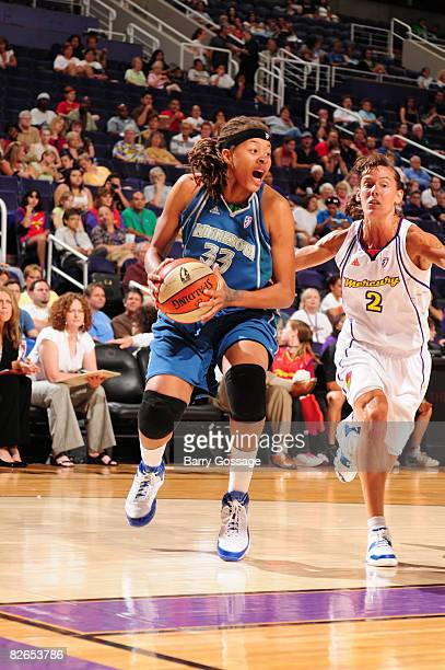 Seimone Augustus of the Minnesota Lynx drives against Kelly Miller of the Phoenix Mercury at US Airways Center September 3 2008 in Phoenix Arizona...