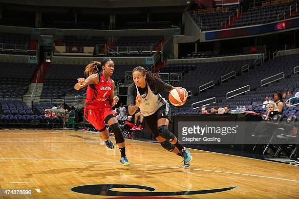 Seimone Augustus of the Minnesota Lynx drives against Tayler Hill of the Washington Mystics during an Analytic Scrimmage at the Verizon Center on May...