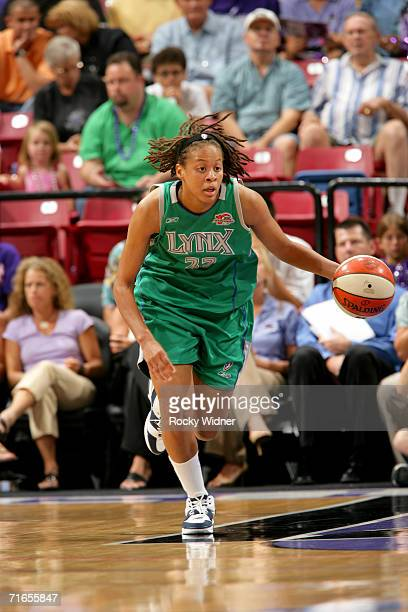 Seimone Augustus of the Minnesota Lynx drives against the Sacramento Monarchs during the game on August 10 2006 at ARCO Arena in Sacramento...