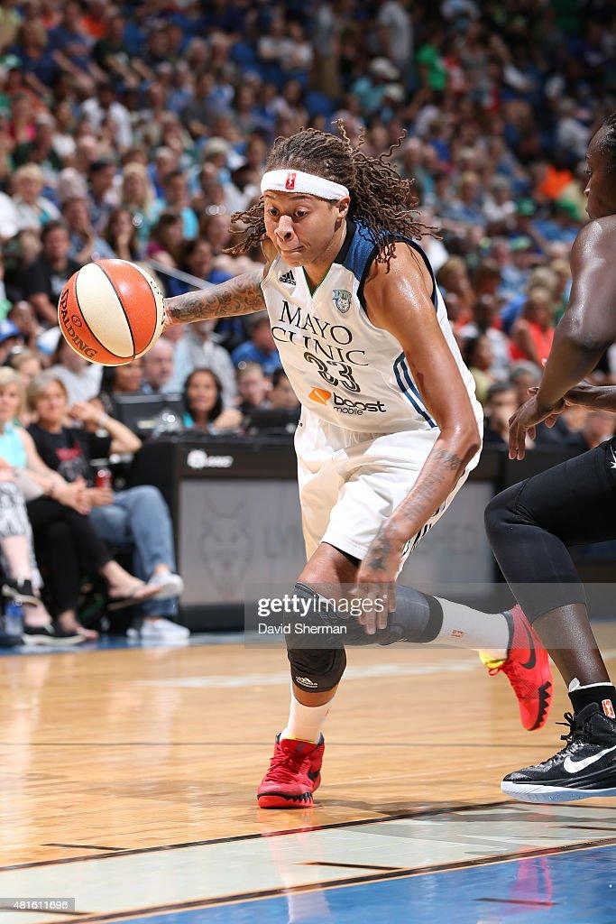 Seimone Augustus #33 of the Minnesota Lynx drives to the basket against the San Antonio Stars on July 12, 2015 at Target Center in Minneapolis, Minnesota.
