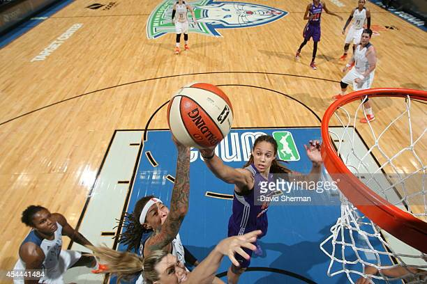 Seimone Augustus of the Minnesota Lynx goes for the shot against Brittney Griner the Phoenix Mercury during the WNBA Western Conference Finals Game 2...