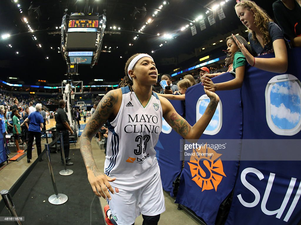 Seimone Augustus #33 of the Minnesota Lynx high fives fans after the game against the San Antonio Stars on July 12, 2015 at Target Center in Minneapolis, Minnesota.