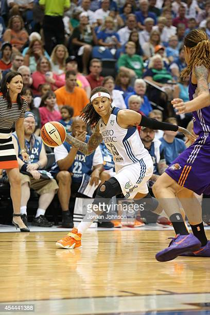Seimone Augustus of the Minnesota Lynx looks to pass against Brittney Griner of the Phoenix Mercury during the WNBA Western Conference Finals Game 2...