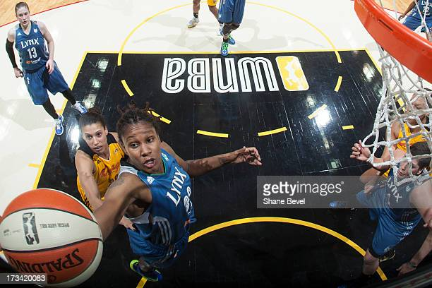 Seimone Augustus of the Minnesota Lynx reaches for a rebound against Nicole Powell of the Tulsa Shock during the WNBA game on July 13 2013 at the BOK...