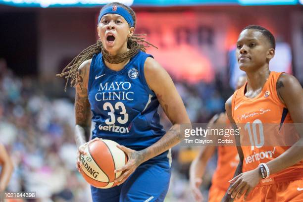 Seimone Augustus of the Minnesota Lynx reacts to a foul call watched by Courtney Williams of the Connecticut Sun during the Connecticut Sun Vs...