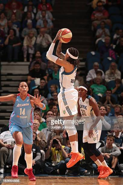 Seimone Augustus of the Minnesota Lynx shoots a jump shot against Erika de Souza of the the Atlanta Dream during Game 2 of the 2013 WNBA Finals on...
