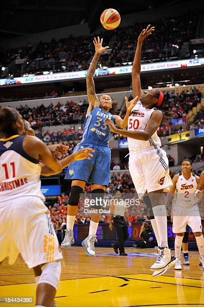 Seimone Augustus of the Minnesota Lynx shoots against Jessica Davenport of the Indiana Fever during Game three of the 2012 WNBA Finals on October 19...