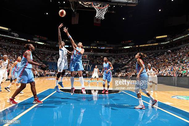 Seimone Augustus of the Minnesota Lynx shoots as Erika de Souza of the Atlanta Dream challenges her in Game Two of the 2011 WNBA Finals on October 5,...