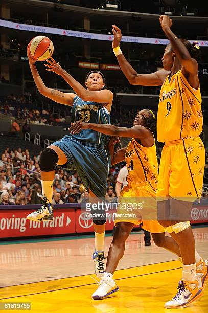 Seimone Augustus of the Minnesota Lynx shoots over Lisa Leslie and Marie FerdinandHarris of the Los Angeles Sparks during the game on July 3 2008 at...