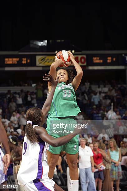 Seimone Augustus of the Minnesota Lynx shoots the ball over Tanty MaigaBa of the Sacramento Monarchs on August 10 2006 at ARCO Arena in Sacramento...