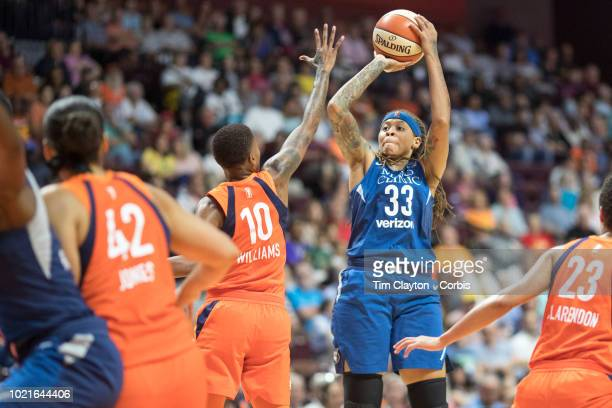 Seimone Augustus of the Minnesota Lynx shoots while defended by Courtney Williams of the Connecticut Sun during the Connecticut Sun Vs Minnesota Lynx...