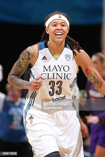 Seimone Augustus of the Minnesota Lynx smiles and runs up court against the Phoenix Mercury during Game One of the WNBA Western Conference Finals on...