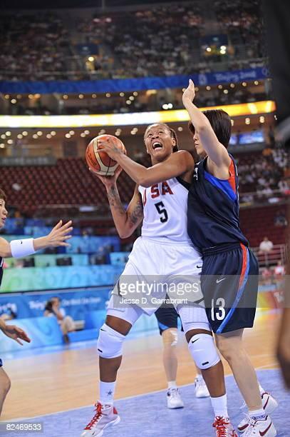 Seimone Augustus of the U.S. Women's Senior National Team shoots against Jung Eun Kim of Korea during their quaterfinal women's basketball game on...