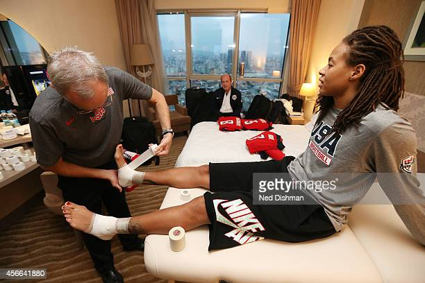 Seimone Augustus of the Women's Senior US National Team gets taped up prior to game against Australia during the semifinal round of the 2014 FIBA...