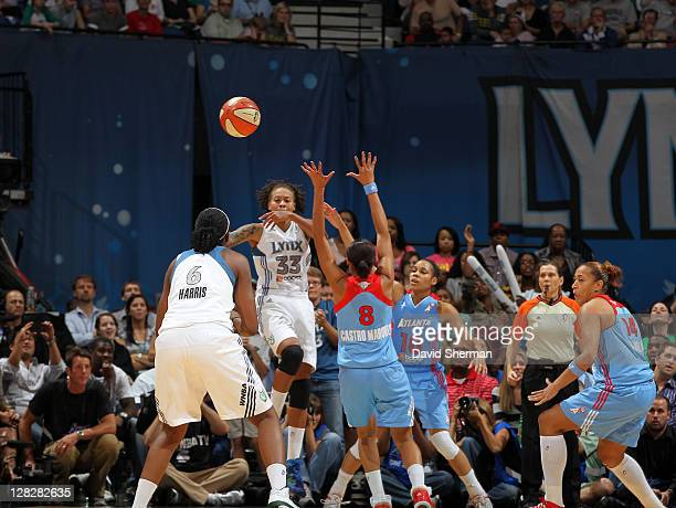 Seimone Augustus passes the ball to set up the first career 3 pointer of Amber Harris of the Minnesota Lynx against the Atlanta Dream in Game Two of...