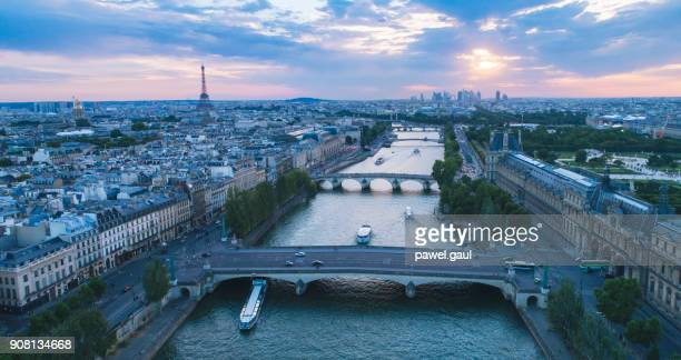 seine river paris sunset aerial - musee du louvre stock photos and pictures