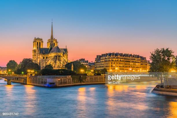 Seine riverfront with Notre-Dame Cathedral at sunset in Paris, France. (Dusk)
