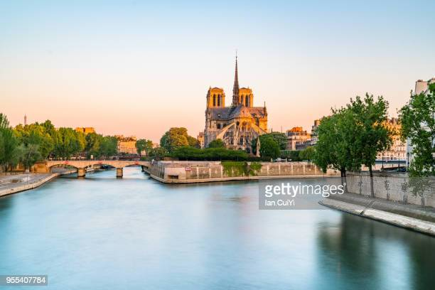 Seine riverfront with Notre-Dame Cathedralat sunrise in Paris, France. (Morning)