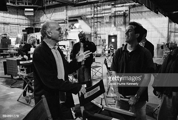 'Seinfeld' cocreators Jerry Seinfeld and Larry David talk on the set in between filming the last episode of the hit television show 'Seinfeld' April...