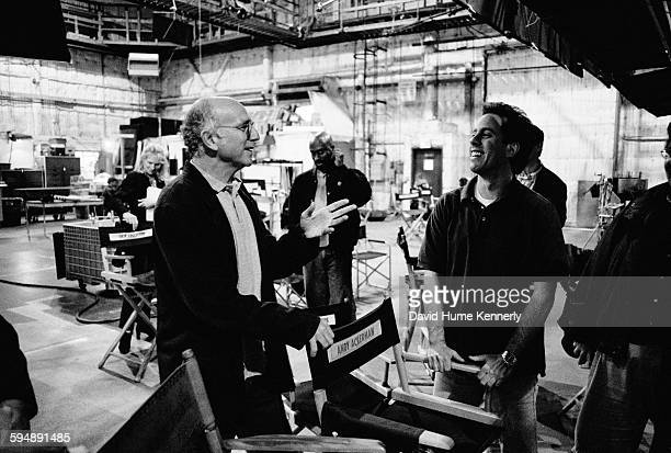 'Seinfeld' cocreators Larry David and Jerry Seinfeld talk on the set in between filming the last episode of the hit television show 'Seinfeld' April...