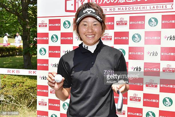 Seira Oki of Japan poses with her ball and club after making a holeinone on the 16th hole during the second round of the HokennoMadoguchi Ladies at...
