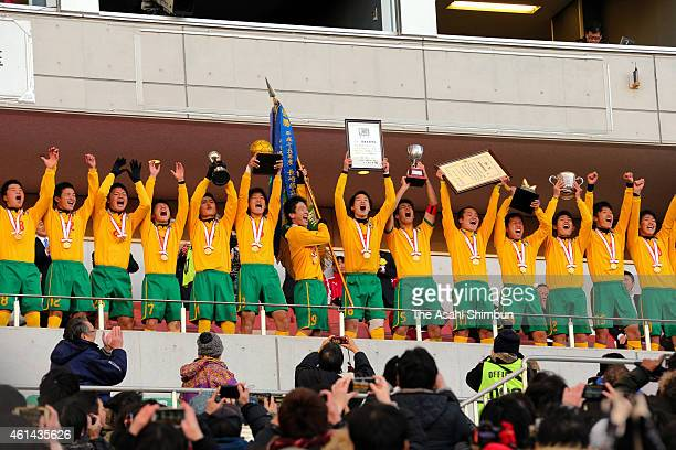 Seiryo players celebrate at the award ceremony afetr their 42 win in the 93rd All Japan High School Soccer Tournament final match between Maebashi...