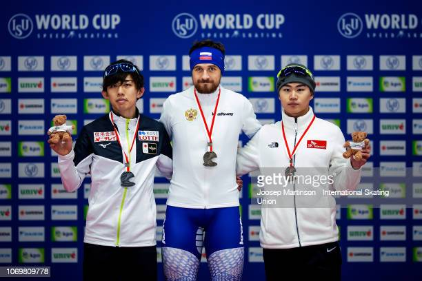 Seitaro Ichinohe of Japan Denis Yuskov of Russia and Min Seok Kim of Korea pose in the Men's 1500m medal ceremony during ISU World Cup Speed Skating...
