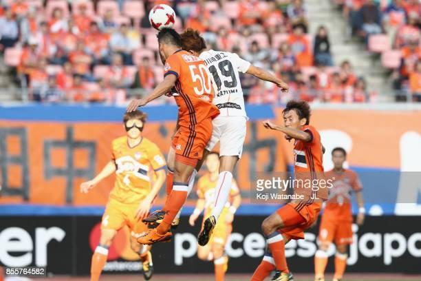 Seitaro Tomisawa of Albirex Niigata and Kazuma Watanabe of Vissel Kobe compete for the ball during the JLeague J1 match between Albirex Niigata and...