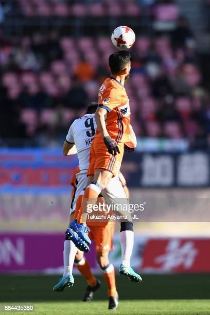 Seitaro Tomisawa of Albirex Niigata and Kenyu Sugimoto of Cerezo Osaka compete for the ball during the JLeague J1 match between Albirex Niigata and...
